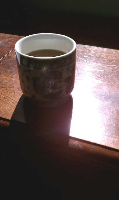Coffee cup, on the desk, in the sun