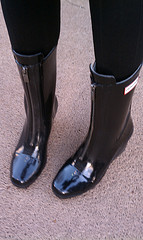 Hunter rain boots with nonfunctional zipper.