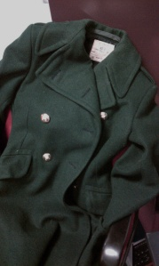 Vintage women's Army coat, draped on office chair.