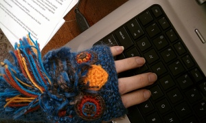 Knit wristwarmers with faces.