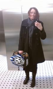 Michael Kors short wool coat, Po Campo Armitage satchel, Bell bike helmet, Fluevog boots.